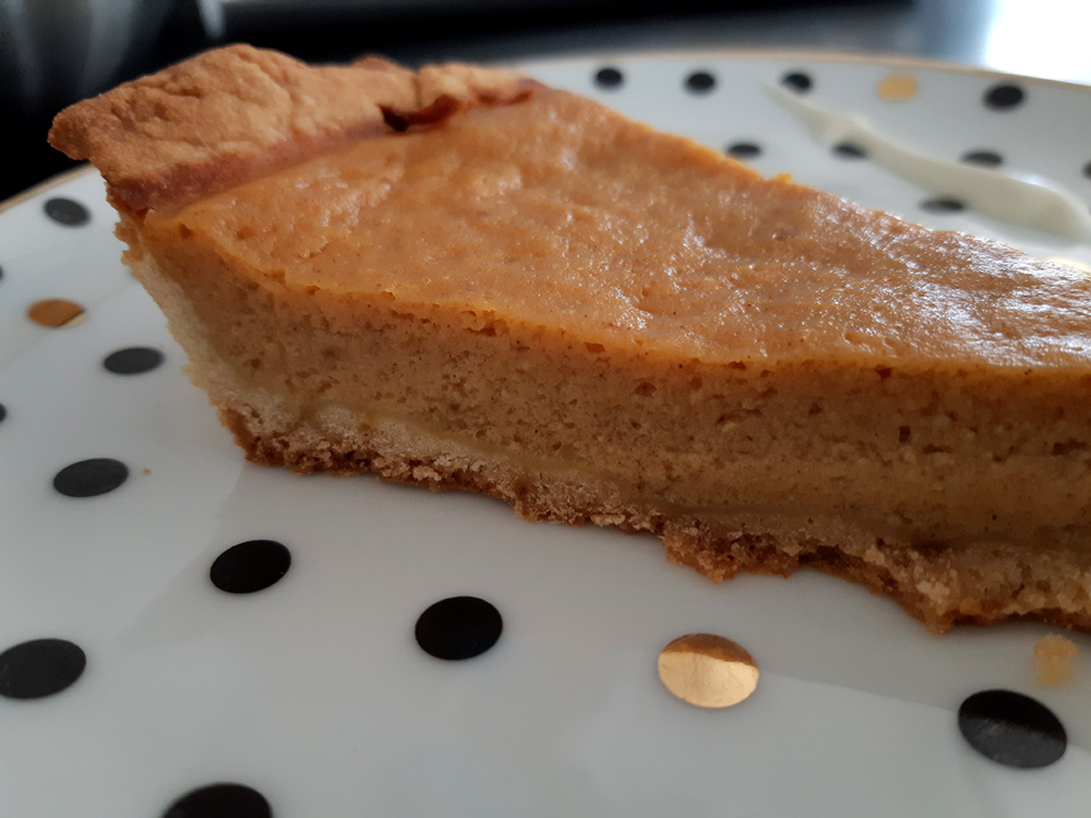 slice of pumpkin pie sour cream